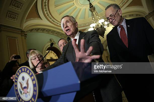 Senate Minority Leader Harry Reid answers questions following the weekly Democratic caucus policy luncheon at the US Capitol February 10 2015 in...