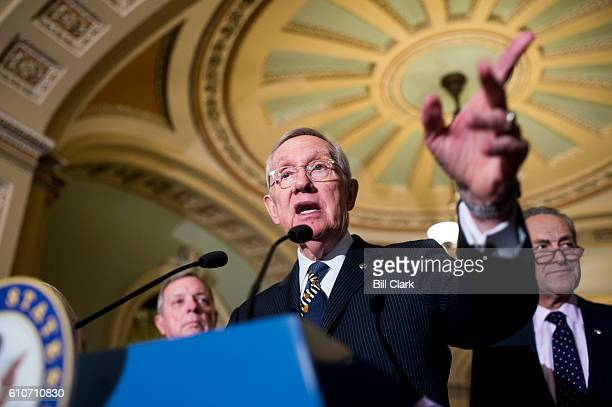 Senate Minority Leader Harry Reid DNev flanked by Sen Richard Durbin DIll and Sen Chuck Schumer DNY speaks to the press about the continuing...