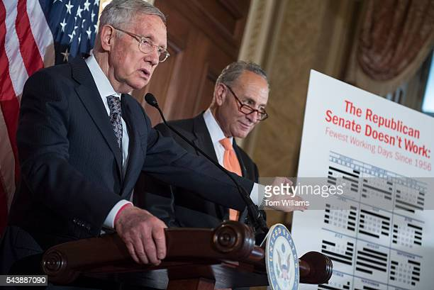 Senate Minority Leader Harry Reid DNev left and Sen Charles Schumer DNY conduct a news conference in the Capitol to call on Republicans to cut the...