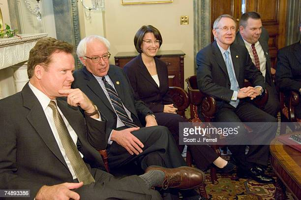 Senate Minority Leader Harry Reid DNev second from right poses for a photo opp with Democratic Senatorselect Reid will take over as Majority Leader...