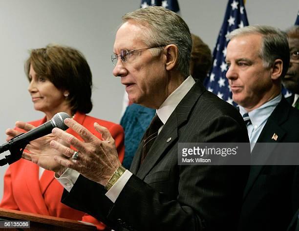 Senate Minority Leader Harry Reid flanked by House Minority Leader Nancy Pelosi and Democratic National Committee Chairman Howard Dean gestures as he...