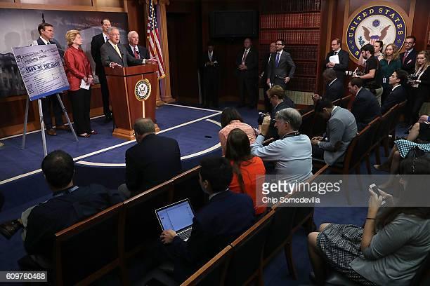 Senate Minority Leader Harry Reid is joined by Sen Chris Murphy and Senate Finance Committee members Sen Debbie Stabenow Sen Ron Wyden and Sen Ben...