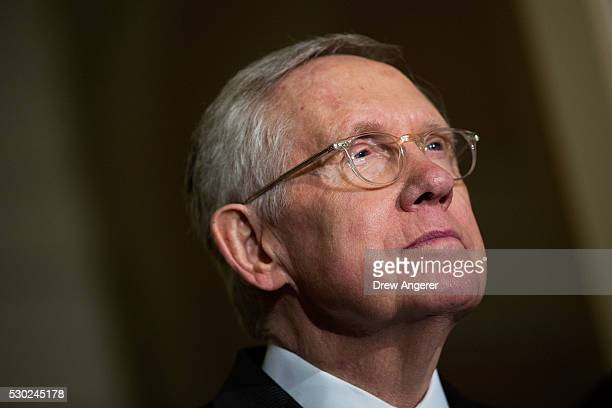 Senate Minority Leader Harry Reid listens to questions from reporters during a news conference after their weekly policy meeting with Senate...