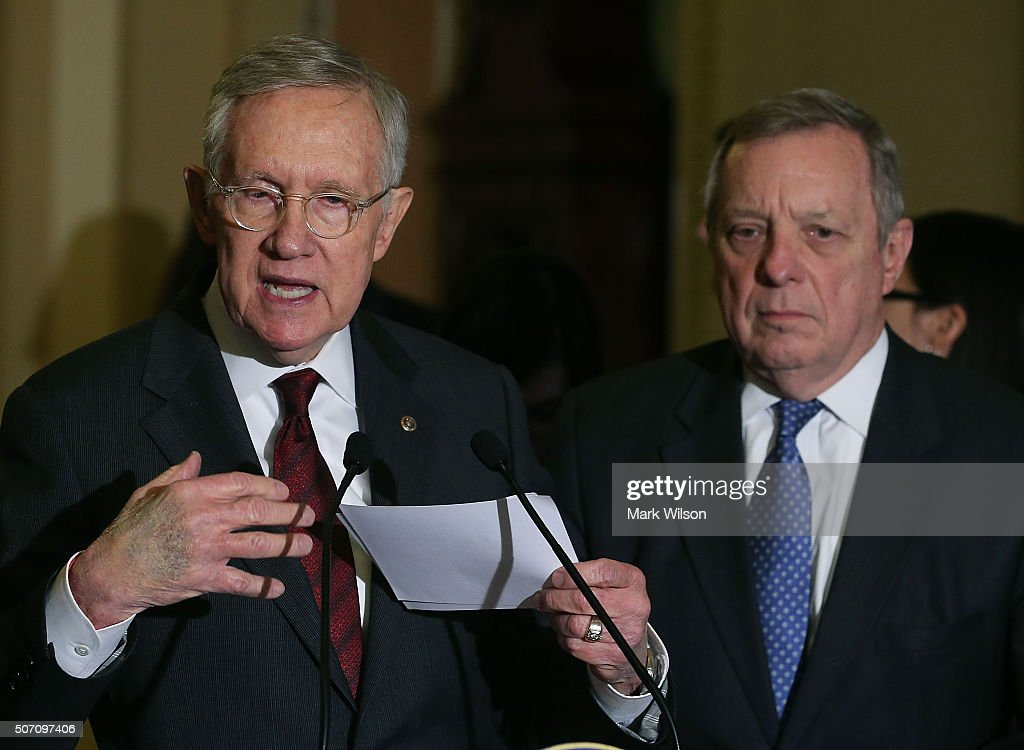 Senate Minority Leader Harry Reid (D-NV) (L), speaks to the media while flanked by Sen. Dick Durbin (D-IL) after attending the weekly Senate Policy Luncheon on Capitol Hill January 27, 2016 in Washington, DC. Reid discussed the comprehensive energy legislation that is before the Senate.