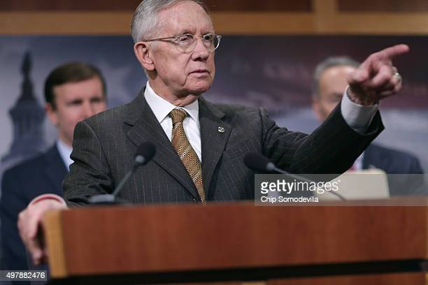 Senate Minority Leader Harry Reid takes questions from reporters during a news conference about Democratic legislative proposals in the wake of last...