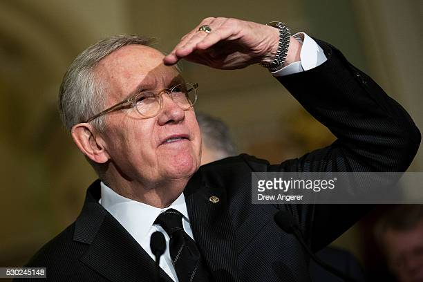 Senate Minority Leader Harry Reid takes questions from reporters during a news conference after their weekly policy meeting with Senate Republicans...