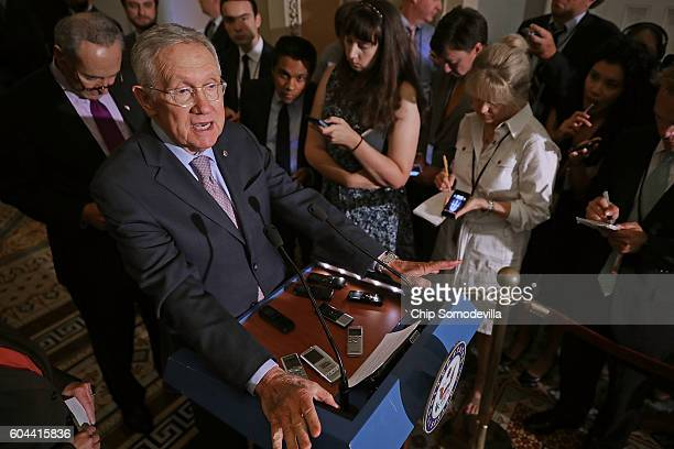 Senate Minority Leader Harry Reid talks to reporters following the weekly Senate Democratic policy luncheon at the US Capitol September 13 2016 in...