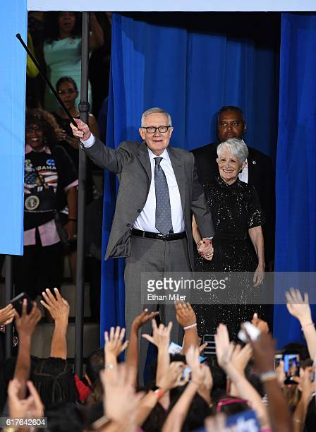 S Senate Minority Leader Harry Reid waves as his wife Landra Reid looks on after he spoke at a campaign rally with US President Barack Obama for...