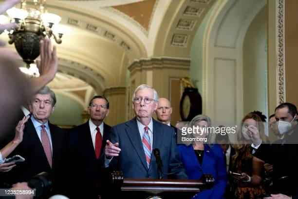 Senate Minority Leader Mitch McConnell, a Republican from Kentucky, center, takes a question during a news conference following Senate Republican...