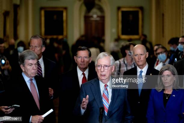 Senate Minority Leader Mitch McConnell, a Republican from Kentucky, center, speaks during a news conference following Senate Republican policy...