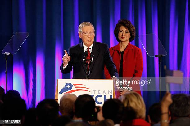 Senate Minority Leader Mitch McConnell a Republican from Kentucky left speaks to supporters alongside his wife Elaine Chao at a Republican Party of...