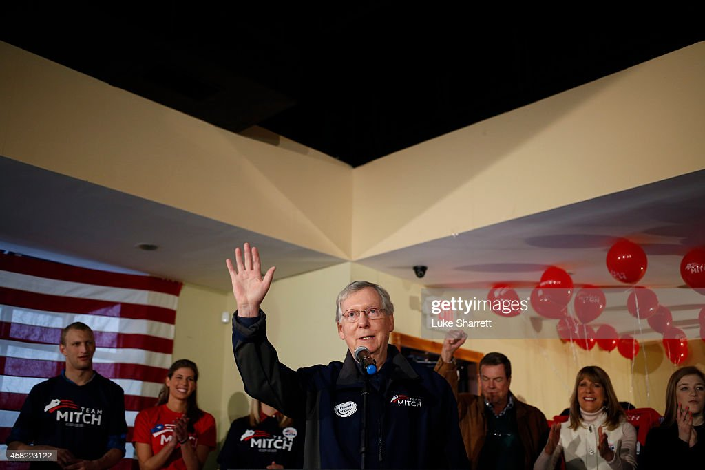 Senate Minority Leader Mitch McConnell (R-KY) acknowledges applause after delivering a stump speech during a campaign stop at the Best Western Airport Expo on November 1, 2014 in Louisville, Kentucky. The most recent Bluegrass Poll shows McConnell with a five point lead over Democratic challenger Alison Lundergan Grimes.