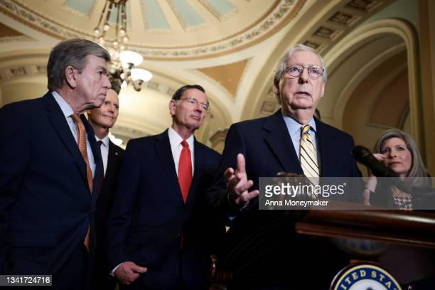 Senate Minority Leader Mitch McConnell addresses reporters as Senate Republican leadership looks on following a weekly Republican policy meeting at...