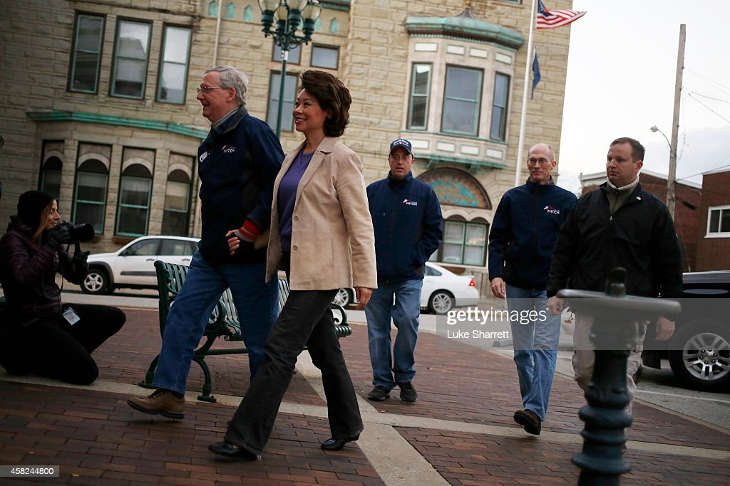 Senate Minority Leader Mitch McConnell (R-KY) and his wife Elaine Chao arrive at a campaign rally at the Scott County Courthouse on Saturday, November 1, 2014 in Georgetown, Kentucky. The most recent Bluegrass Poll shows McConnell with a five point lead over Democratic challenger Alison Lundergan Grimes.