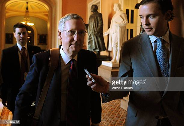 S Senate Minority Leader Mitch McConnell arrives on Capitol Hill for a postponed vote on the debt ceiling on July 31 2011 in Washington DC As the...