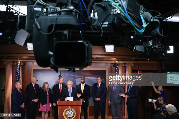 Senate Minority Leader Mitch McConnell joins Sen. Lindsey Graham and other Senate Republicans during a news conference at the U.S. Captiol on July...