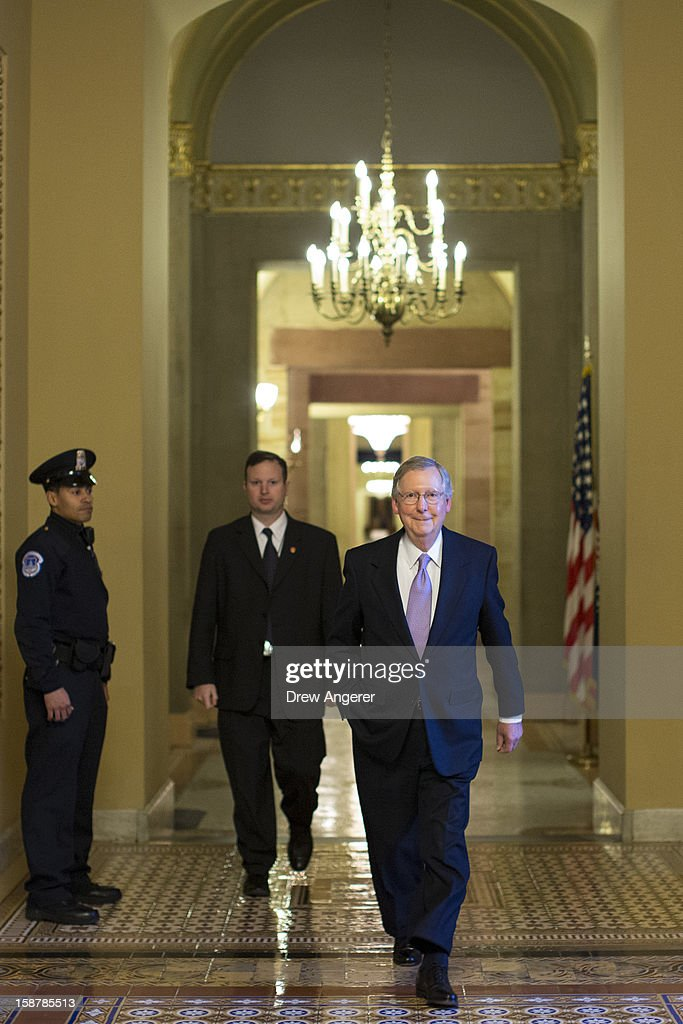 Senate Minority Leader Mitch McConnell (R-KY) leaves his office and walks toward the Senate floor on Capitol Hill December 28, 2012 in Washington, DC. The Senate was back in session on Friday to deal with the looming 'fiscal cliff' issue.