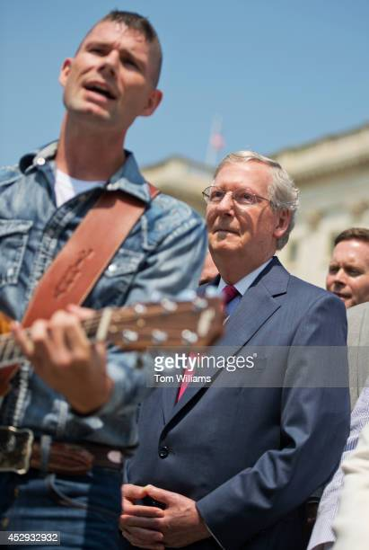 Senate Minority Leader Mitch McConnell, R-Ky., listens to singer and former coal miner Jimmy Rose of Pineville, Ky., perform during a news conference...