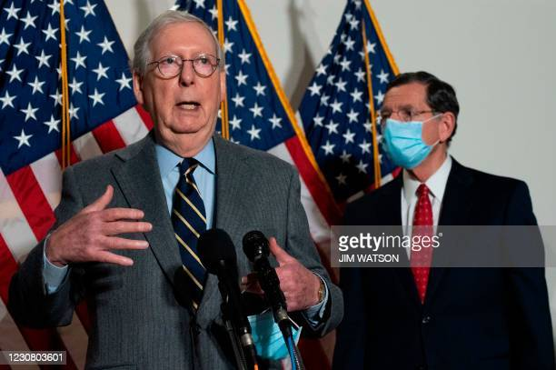 Senate Minority Leader Mitch McConnell , R-KY, speaks with US Senator John Barrasso , R-WY, after the Republican Policy Luncheon on Capitol Hill in...