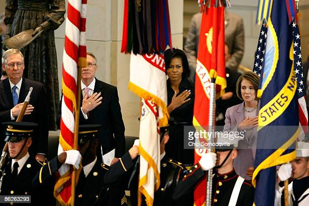 Senate minority leader Mitch McConnell Senate Majority Leader Harry Reid First Lady Michelle Obama and Speaker of the House Nancy Pelosi listen to...