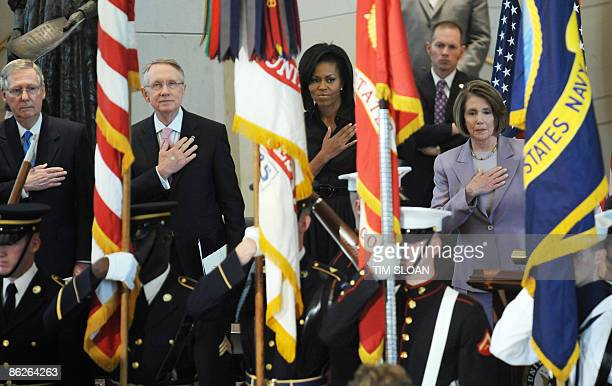 Senate Minority Leader Mitch McConnell Senate Majority Leader Harry Reid US First Lady Michelle Obama and Speaker of the House Nancy Pelosi listen to...