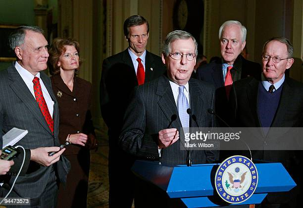 Senate Minority Leader Mitch McConnell speaks about the health care bill while flanked by Sen Jon Kyl Sen Lisa Murkoski John Thune Sen John Cornyn...