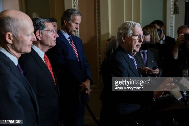Senate Minority Leader Mitch McConnell speaks to reporters following a weekly Republican policy luncheon as Sen. Rick Scott , Sen. John Barrasso and...