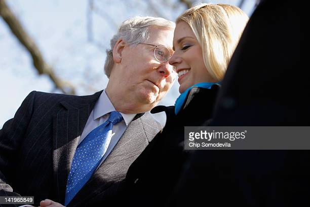 Senate Minority Leader Mitch McConnell speaks with Florida Attorney General Pam Bondi during a news conference about the Supreme Court's second day...
