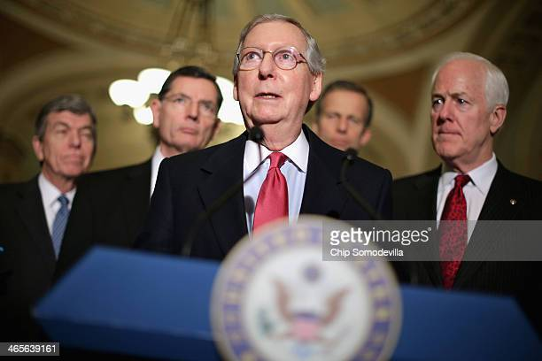 Senate Minority Leader Mitch McConnell talks to reporters after the weekly Republican Senate caucus luncheon with Sen Roy Blunt Sen John Barrasso Sen...