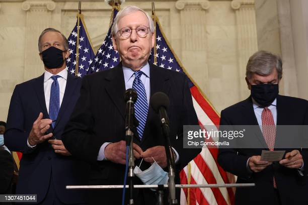 Senate Minority Leader Mitch McConnell talks to reporters with Sen. John Thune and Sen. Roy Blunt following the weekly Senate Republican caucus...