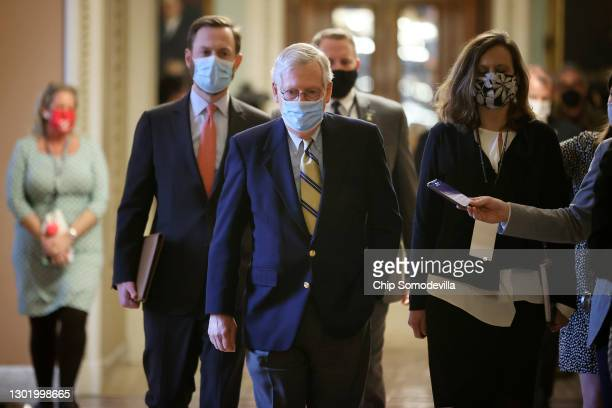 Senate Minority Leader Mitch McConnell walks to his office at the conclusion of former President Donald Trump's impeachment trial at the U.S. Capitol...