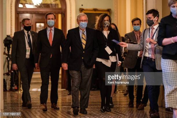 Senate Minority Leader Mitch McConnell walks to his office in the U.S. Capitol Building on Saturday, Feb. 13, 2021 in Washington, DC. By a vote of 57...