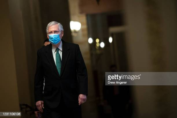 Senate Minority Leader Mitch McConnell walks to the Senate Chamber on the third day of former President Donald Trump's second impeachment trial at...