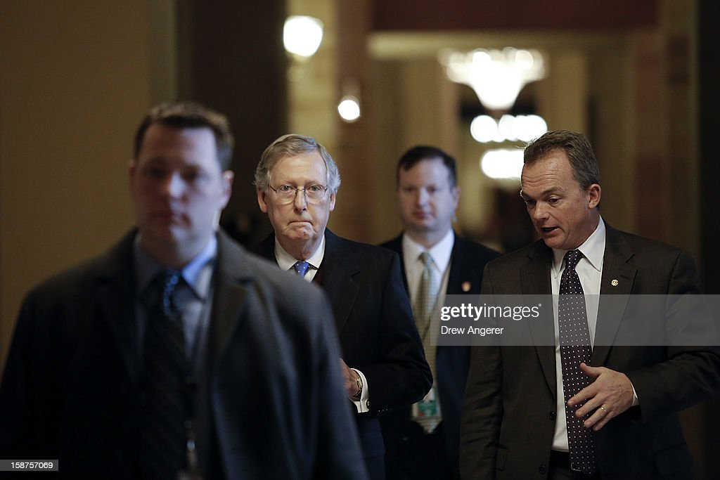 Senate Minority Leader Mitch McConnell (R-KY) (2nd from L) walks toward the Senate Chamber on Capitol Hill December 27, 2012 in Washington, DC. Senators returned to Capitol Hill on Thursday to deal with the looming 'Fiscal Cliff.'
