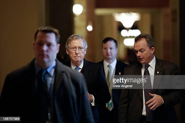 Senate Minority Leader Mitch McConnell walks toward the Senate Chamber on Capitol Hill December 27, 2012 in Washington, DC. Senators returned to...