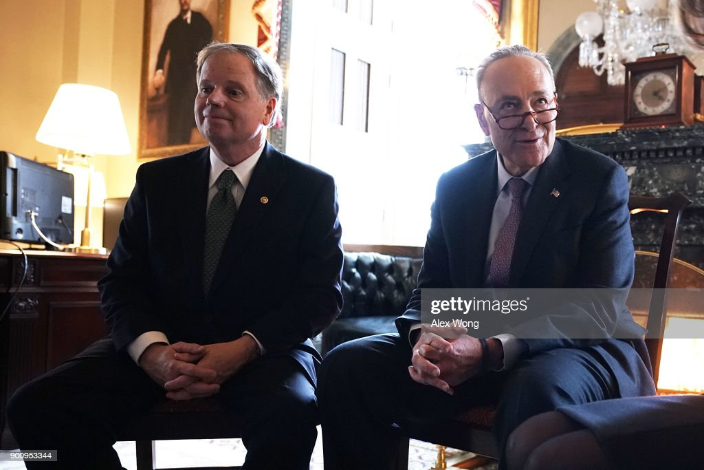 U.S. Senate Minority Leader Sen. Chuck Schumer (D-NY) (R) and Sen. Doug Jones (D-AL) meet at the U.S. Capitol January 3, 2018 in Washington, DC. Sen. Tina Smith (D-MN), the other newly sworn-in Democratic Senator, also attended the meeting.