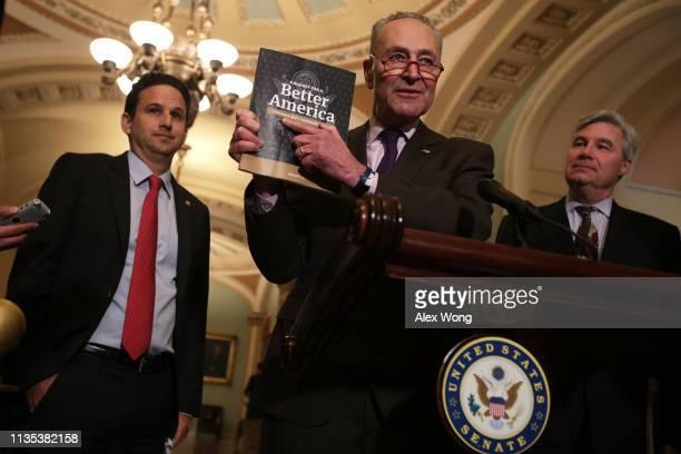 S Senate Minority Leader Sen Chuck Schumer holds up a copy of US President Donald Trump's FY2020 budget request as Sen Brian Schatz and Sen Sheldon...