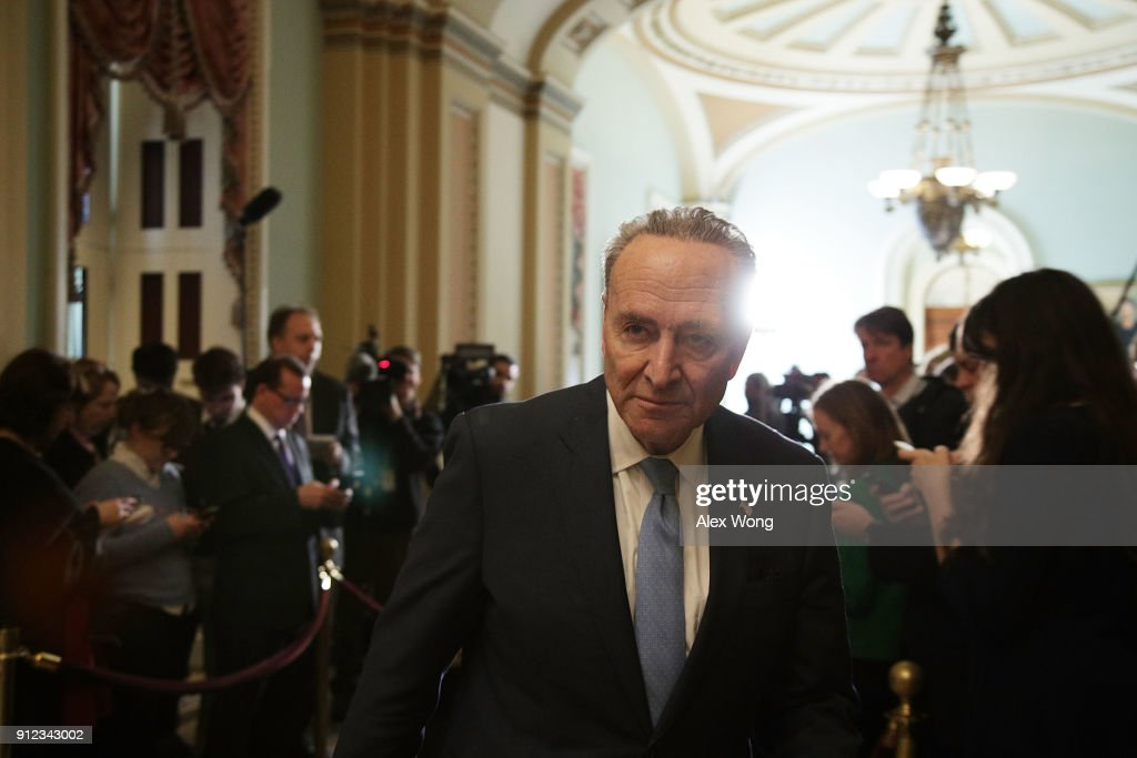 U.S. Senate Minority Leader Sen. Chuck Schumer (D-NY) leaves after speaking to members of the media during a news briefing January 30, 2018 at the Capitol in Washington, DC. U.S. President Donald Trump will give his first State of the Union address during a joint session of the Congress tonight.