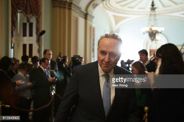S Senate Minority Leader Sen Chuck Schumer leaves after speaking to members of the media during a news briefing January 30 2018 at the Capitol in...
