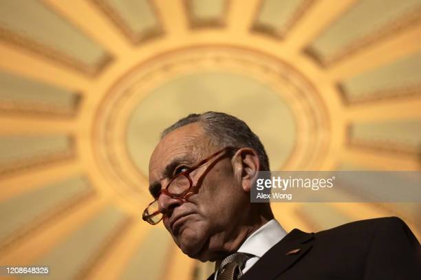 Senate Minority Leader Sen. Chuck Schumer listens during a news briefing after the weekly Senate Democratic policy luncheon at the U.S. Capitol...