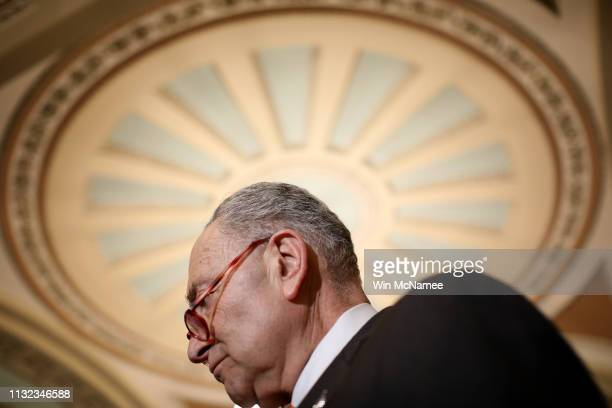 Senate Minority Leader Sen Chuck Schumer listens to questions from reporters following the weekly Democratic policy luncheon at the US Capitol...