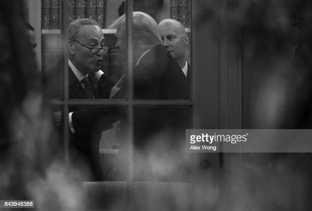 US Senate Minority Leader Sen Chuck Schumer makes a point to President Donald Trump in the Oval Office as White House Director of Legislative Affairs...