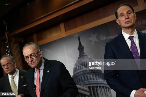 Senate Minority Leader Sen. Chuck Schumer , Sen. Tom Carper and Sen. Ron Wyden listen during a news conference at the Capitol March 7, 2018 in...