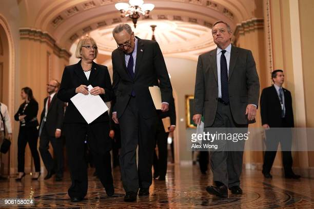 S Senate Minority Leader Sen Chuck Schumer Senate Minority Whip Sen Dick Durbin and Sen Patty Murray approach the podium to speak to members of the...