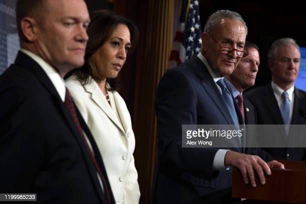 S Senate Minority Leader Sen Chuck Schumer speaks as Sen Chris Coons Sen Kamala Harris Sen Richard Blumenthal and Sen Chris Van Hollen listen during...