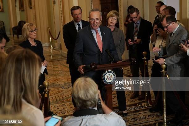 S Senate Minority Leader Sen Chuck Schumer speaks as Sen Maggie Hassan Sen Chris Murphy and Sen Tammy Baldwin listen during a news briefing after a...