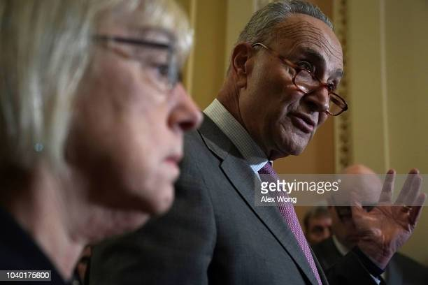 S Senate Minority Leader Sen Chuck Schumer speaks as Sen Patty Murray listens after a weekly Senate Democratic policy luncheon September 25 2018 at...