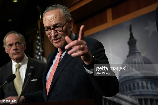 Senate Minority Leader Sen. Chuck Schumer speaks as Sen. Tom Carper listens during a news conference at the Capitol March 7, 2018 in Washington, DC....
