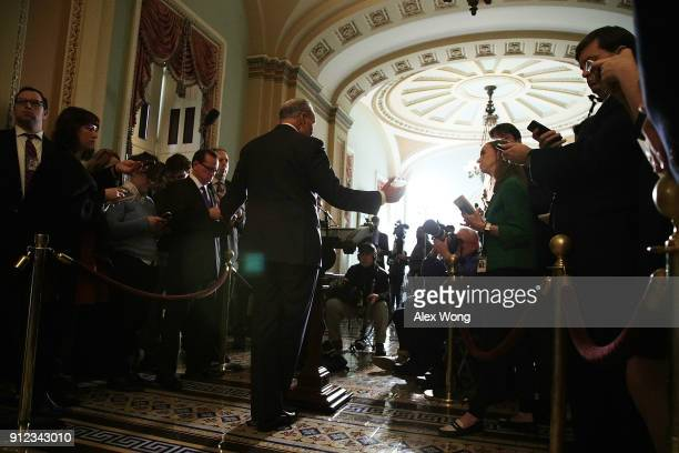 S Senate Minority Leader Sen Chuck Schumer speaks to members of the media during a news briefing after the weekly Senate Democratic Policy Luncheon...