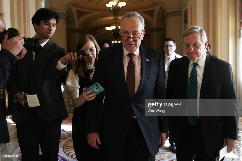 U.S. Senate Minority Leader Sen. Chuck Schumer (D-NY) (2nd R) speaks to members of the media as he walks with Senate Minority Whip Sen. Dick Durbin (D-IL) (R) at the Capitol December 1, 2017 in Washington, DC. Senate GOPs indicate that they have enough votes to pass the tax reform bill.